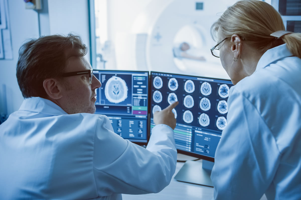 Medical professionals looking over MRI results in real time
